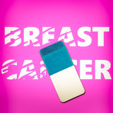 Eraser erasing the words BREAST CANCER stock photos