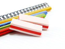 Eraser with notebook and pencil Stock Photos
