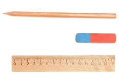 Eraser, pencil and ruler on a white background. Royalty Free Stock Images