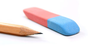 Eraser and pencil on a white background. Stock Images