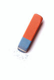 Eraser or rubber with rubber residue on white. Blue and red eraser or rubber with rubber residue on white conceptual of school, art and office supplies Royalty Free Stock Photo