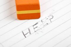 Eraser and sign help Stock Photos