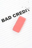 Eraser and word bad credit. Concept of making change stock images
