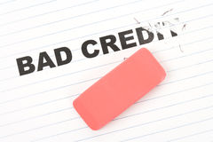 Eraser and word bad credit. Concept of making change Royalty Free Stock Images