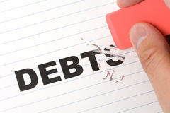 Eraser and word debt Stock Images