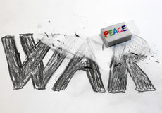 Eraser with written PEACE deletes the written WAR Stock Photography