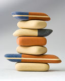 Erasers. Colored rubber erasers stack on a gray background Royalty Free Stock Photo