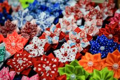 Erasers for hair from ribbons. Bright decoration for hair of han royalty free stock image