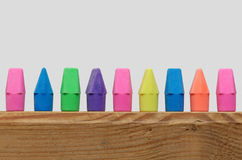 Erasers in a Row. Colorful Pencil Erasers in Line on Shelf Stock Images