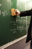 Erasing a blackboard Royalty Free Stock Photos