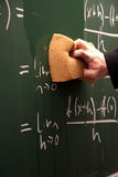 Erasing a blackboard Stock Photos