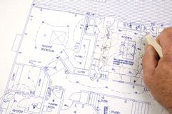 Erasing changes made to plans. Erasing changes made to a set of building plans for a custom house Stock Photo