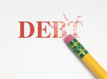 Erasing Debt. Close up of a yellow pencil erasing the word, 'debt' in red