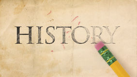 Erasing History. Close up of a yellow pencil erasing the word, 'History' from old, stained and yellowing paper Stock Image