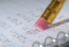 Erasing a mistake on a piece of paper. Erasing a mistake on a piece of paper close up Stock Photography