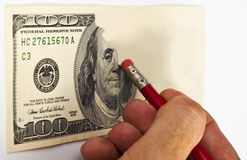 Erasing money Stock Photography
