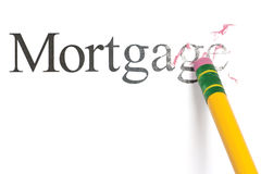Erasing Mortgage. Close up of a yellow pencil erasing the word, 'Mortgage.' Isolated on white Stock Photo