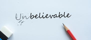 Erasing unbelievable text change to believable. challenge, positive thinking and success concept royalty free illustration