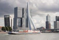 Erasmus Bridge and Container Ship Cargo Ship on Nieuwe Maas ri Stock Photos