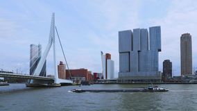 Erasmus Bridge in Rotterdam, Netherlands. Erasmus Bridge and `De Rotterdam`, Wilhelminakade, Rotterdam, Netherlands stock video