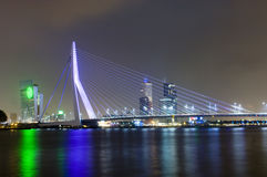 Erasmus Bridge by Night. The famous Erasmus Suspension bridge with the Rotterdam skyline in the background at night, reflecting in the river Meuze royalty free stock image