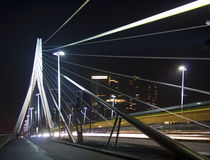 The Erasmus Bridge, Rotterdam. The Erasmus Bridge in the evening. A perspective view of the structure in the dark. The dynamism is enhanced by the light traces Royalty Free Stock Photography