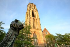 Erasmus Statue, a bronze sculpture unveiled in 1622 and located on Grotekerkplein Square, with St Lawrence Church Laurenskerk in. The background, Rotterdam stock photography