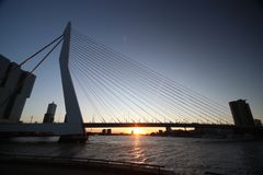 Erasmusbrug, big bridge in Rotterdam named to Erasmus during sunset in the winter. With view over Nieuwe Maas Stock Image