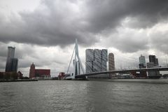 Erasmusbrug a bridge in the middle of Rotterdam with Skyline and dark clouds in the netherlands.  Stock Image
