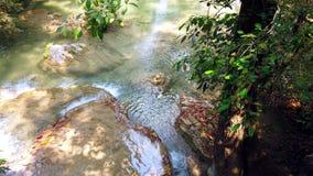 Erawan national park or Erawan waterfall at Kanchanaburi province in Thailand. travel vacation trip. 4K stock video footage