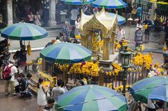 Erawan Shrine and people praying Thao Maha Phrom or Lord Brahma at Ratchaprasong Stock Photos