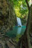 Erawan Waterfall with fish in water Stock Images