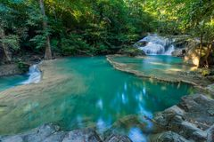 Erawan Waterfall with fish in water Royalty Free Stock Image