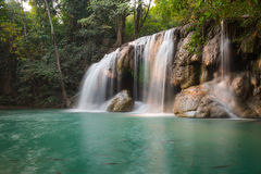 Erawan waterfall. Waterfall in green forest in Thailand Royalty Free Stock Photo