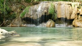 Erawan waterfall , popular famous tourist attraction in Kanchanaburi, Thailand. Erawan waterfall is a waterfall in tropical rain forest, popular with both Thai stock video footage