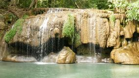 Erawan waterfall , popular famous tourist attraction in Kanchanaburi, Thailand. Erawan waterfall is a waterfall in tropical. Rain forest, popular with both Thai stock footage