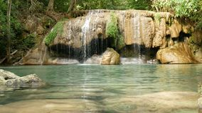 Erawan waterfall , popular famous tourist attraction in Kanchanaburi, Thailand. Erawan waterfall is a waterfall in tropical. Rain forest, popular with both Thai stock video footage