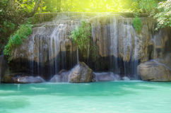 Erawan waterfall in tropical rain forest Stock Photos