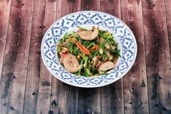 Erba cipollina cinese fritta piccante con la milza del pollo Fotografie Stock Libere da Diritti