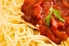 Erba del prezzemolo su spaghetti con Immagini Stock