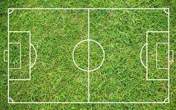 Erba di un campo di calcio Fondo del campo di calcio o del campo di football americano immagine stock libera da diritti
