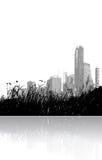 Erba e città riflesse Fotografie Stock