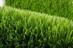 Erba verde artificiale Immagini Stock