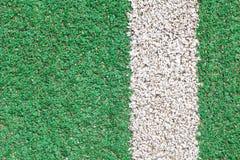 Erba verde e striscia di bianco Fotografia Stock
