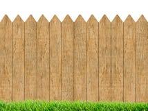 Erba verde fresca sopra il fondo di legno del recinto Fotografia Stock