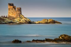 Erbalunga old Tower. Erbalunga tower and harbour with rocks on foreground, Corsica, France Royalty Free Stock Photos