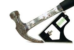 Erbauer Hammer und Stufe Stockbild