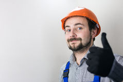 Erbauer im Schutzhelm Stockfotografie