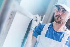 Erbauer Worker mit Baugerüst stockfoto