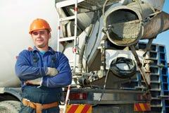 Erbauerarbeitskraft an der Baustelle Stockfoto